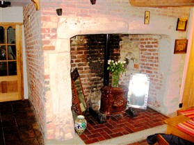 Photo:Clunch and brick fireplace