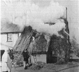 Photo:Fire in the thatch.
