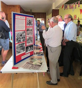 Photo:Evacuee David Lloyd finds his photo in the wartime exhibition