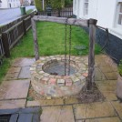 Photo:The well at Well Cottage. It is about ten feet deep, and has water in it.