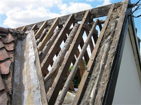 Photo:Modern square sawn timber over the old rustic poles at No.26