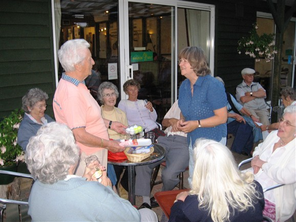 Photo:Joy Miller (left) presents the prizes. Golf Evening July 2009