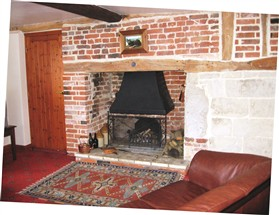 Photo:The fireplace is partly brick and partly clunch.