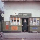 Photo:Dorothy King (Parcell) at her shop door c 1960