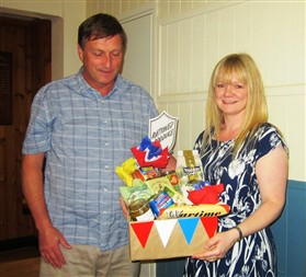 Photo:Gerry and Helen Burrell - Winners of the Raffle Rations