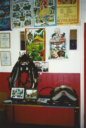 Photo:Part of Alan Neaves' harness collection. Tea towels on the wall were just a few of the dozens collected and displayed by Mrs Olive Kruger