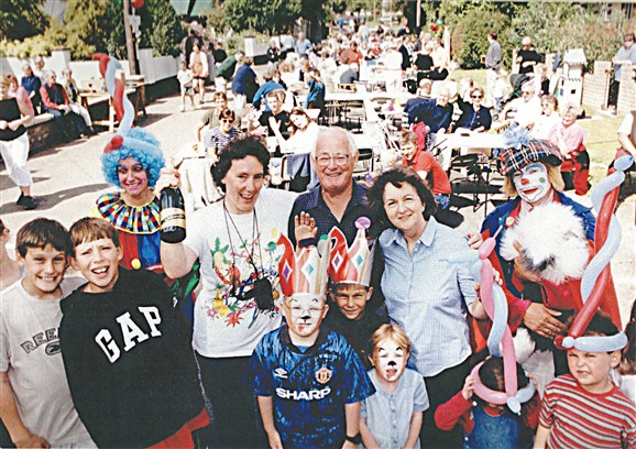 Photo:Part of the organising team (Katie Reid, Roy Primett and Sue Miller), surrounded by happy children and a couple of clowns.