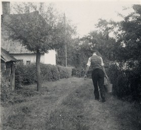 Photo:Carrying home water from the Chapel Orchard well in the 1940s