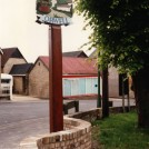 Photo:Village sign 2011 - and the hairdressers behind.