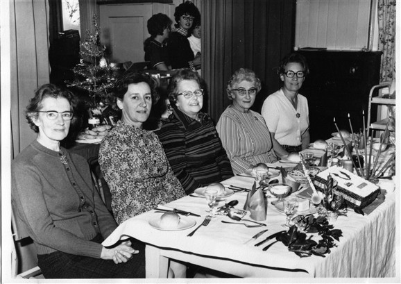 Photo:W.I. dinner in the sixties. County Representative, Joy Miller, Connie Arnold, Addie Mitchell & Peggy Miller.