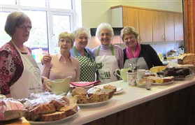 Photo:2012 WI serving tea and cakes for the antiques fair in the hall