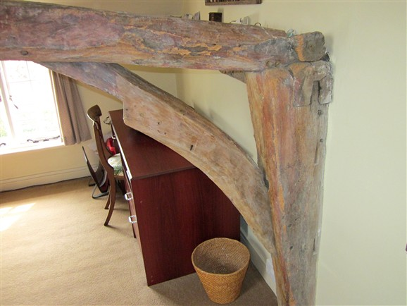 Photo:Complex joint in the old roof structure. The arched tie beam, swell headed upright, and angle bracing  (cut away at a later date to improve headroom) are indicative of construction in the early 1600's.